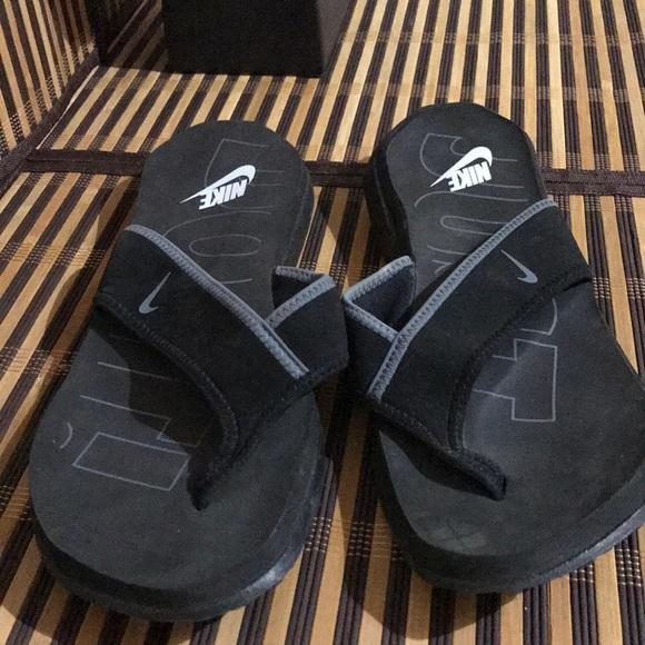 13f570f18be3 Nike Men s Nike Celso Flip Flops Black. M 5aa99859fcdc31a5e59155dd